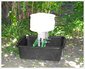 Mosquito trap:  the bucket contains fetid water, attractive to a gravid female mosquito looking for a place to lay her eggs, some dry ice
