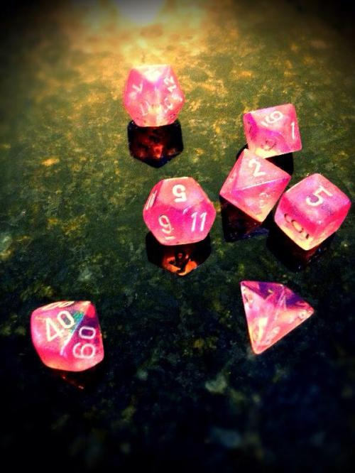 A very special time in a young girl's life - her first gaming dice. (First d20 roll was a 17)